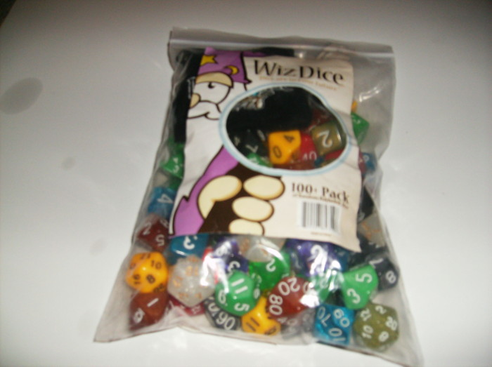 A zipper bag full of dice