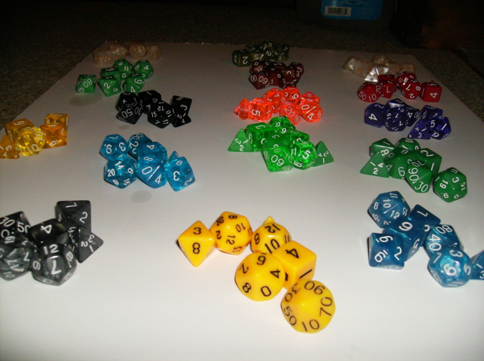 Different sets of dice laid out on floor