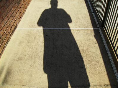 Doug's shadow on the ground at Fontainbleu Apartments